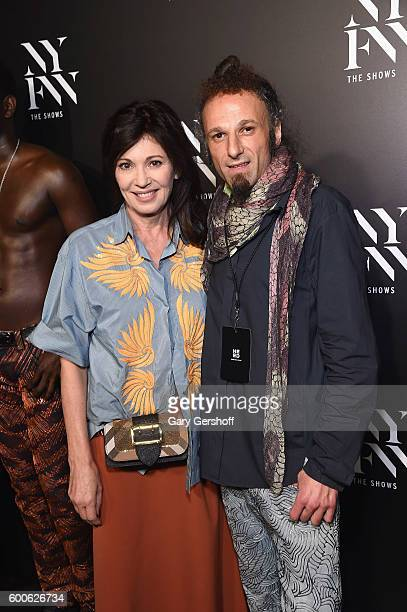 German actress Iris Berben and designer Johny Dar pose backsatage at the Jeans for Refugees by Johnny Dar fashion show during New York Fashion Week...