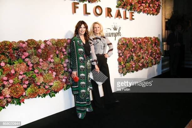 German actress Iris Berben and German presenter Barbara Schoeneberger attend the Florale By Triumph Dinner Hosted By Julianne Moore Dinner at Altes...