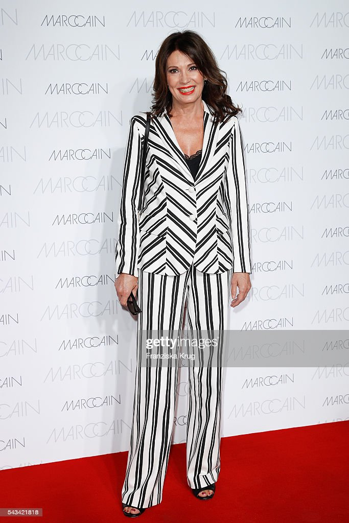German actress <a gi-track='captionPersonalityLinkClicked' href=/galleries/search?phrase=Iris+Berben&family=editorial&specificpeople=226774 ng-click='$event.stopPropagation()'>Iris Berben</a> attends the Marc Cain fashion show Spring/Summer 2017 at CITY CUBE Panorama Bar on June 28, 2016 in Berlin, Germany.