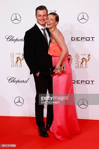 German actress Jessica Schwarz and partner Markus Selikovsky pose for photographers as they arrive at the Bambi awards on November 17 2016 in Berlin...