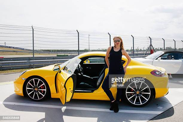 German actress Julia Dietze in front of a Porsche 911 Carrera S wearing a total look from the Porsche Design Woman SS17 Collection at the 'Porsche...