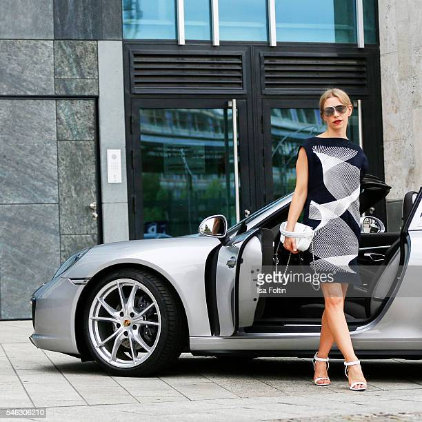 German actress Julia Dietze in front of a Porsche 911 Targa 4 wearing a total look and the VisorBag from Porsche Design Women SS17 Collection at the...