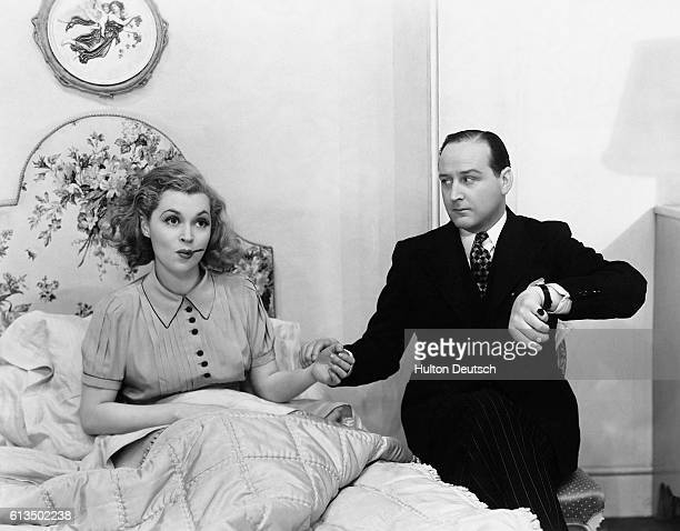 German actress Lilli Palmer and English actor Cecil Parker in a scene from the play Little Ladyship showing at the Strand Theatre in London England...