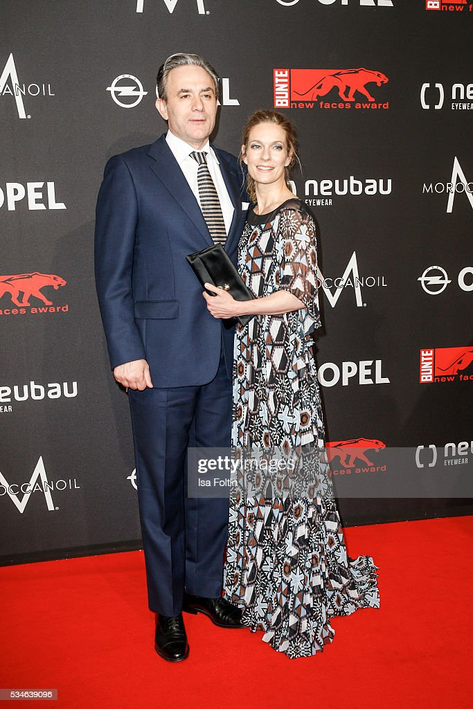 German actress <a gi-track='captionPersonalityLinkClicked' href=/galleries/search?phrase=Lisa+Martinek&family=editorial&specificpeople=228950 ng-click='$event.stopPropagation()'>Lisa Martinek</a> (Dress by Talbot Runhof) and her husbandGiulio Ricciarelli attend the New Faces Award Film 2016 at ewerk on May 26, 2016 in Berlin, Germany.