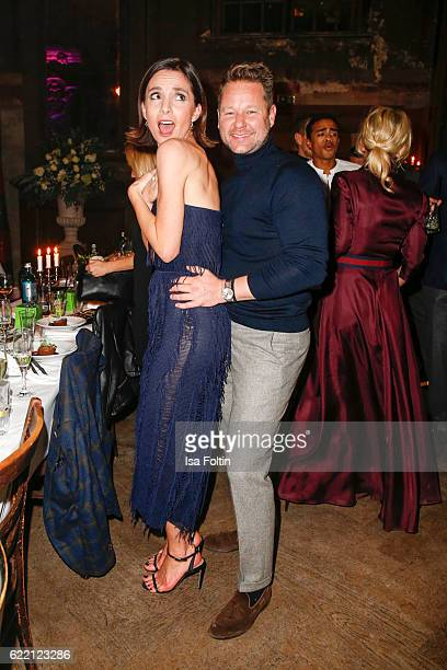 German actress Nadine Warmuth and Bastian Ammelounx CEO La Martina Germany attend the La Martina x GQ PreDinner on November 9 2016 in Berlin Germany