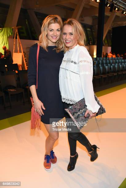 German actress Nina Bott and german moderator Nova Meierhenrich attend the Tchibo 'Ready for the Green Carpet' Fashion Show on March 8 2017 in...