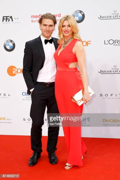 German actress Nina Bott and her partner Benni Baarz during the Lola German Film Award red carpet arrivals at Messe Berlin on April 28 2017 in Berlin...