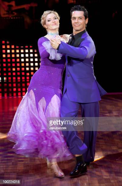 German actress Nina Bott and professional dancer Roberto Albanese dance during the semi final of the 'Let's Dance' TV show at Studios Adlershof on...