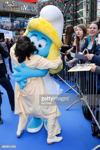 German actress Nora Tschirner dances with smurf 'Schlumpfine' during the 'Die Schluempfe Das verlorene Dorf' premiere at Sony Centre on April 2 2017...