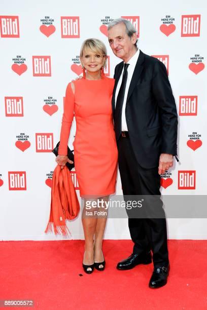 German actress Uschi Glas and her husband Dieter Hermann attend the 'Ein Herz fuer Kinder Gala' at Studio Berlin Adlershof on December 9 2017 in...