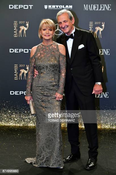 German actress Uschi Glas and her husband Dieter Hermann pose upon their arrival for the 2017 BAMBI awards ceremony on November 16 2017 at the Stage...