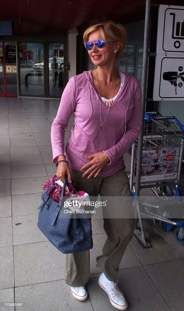 German actress Veronica Ferris arrives at Tegel Airport on July 12, 2013 in Berlin, Germany.