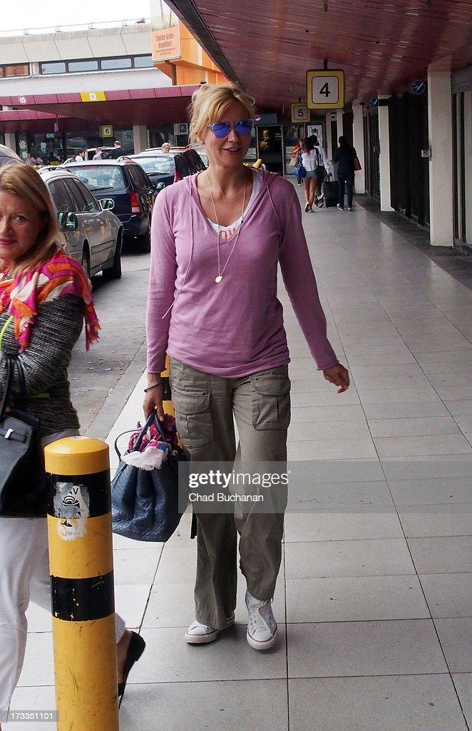 German actress Veronica Ferris arrives at Tegel Airport on July 12, 2013 in Berlin, Germany.