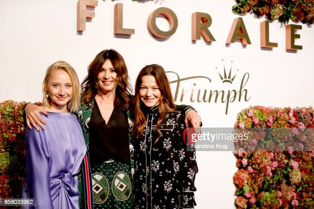 German actresses Anna Maria Muehe Iris Berben and Hannah Herzsprung attend the Florale By Triumph Dinner Hosted By Julianne Moore at Altes Stadthaus...
