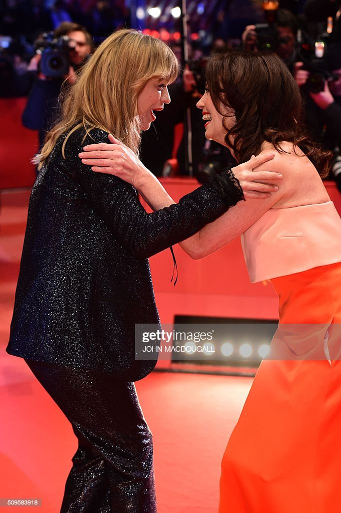 German actresses Heike Makatsch (L) and Iris Berben arrive on the red carpet for the film 'Hail, Caesar!' screening as opening film of the 66th Berlinale Film Festival in Berlin on February 11, 2016. Eighteen pictures will vie for the Golden Bear top prize at the event which runs from February 11 to 21, 2016. / AFP / John MACDOUGALL