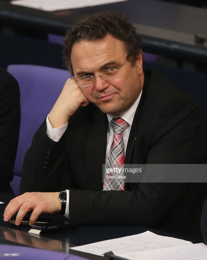 German Agriculture and Consumer Protection Minister <a gi-track='captionPersonalityLinkClicked' href=/galleries/search?phrase=Hans-Peter+Friedrich&family=editorial&specificpeople=7528072 ng-click='$event.stopPropagation()'>Hans-Peter Friedrich</a> attends debates at the Bundestag following a government declaration given by German Chancellor Angela Merkel, in which she outlined the policy priorities of the new German coalition government of Christian Democrats and Social Democrats, on January 29, 2104 in Berlin, Germany. The new government was sworn in in December and has a strong majority in the Bundestag to push through legislation.