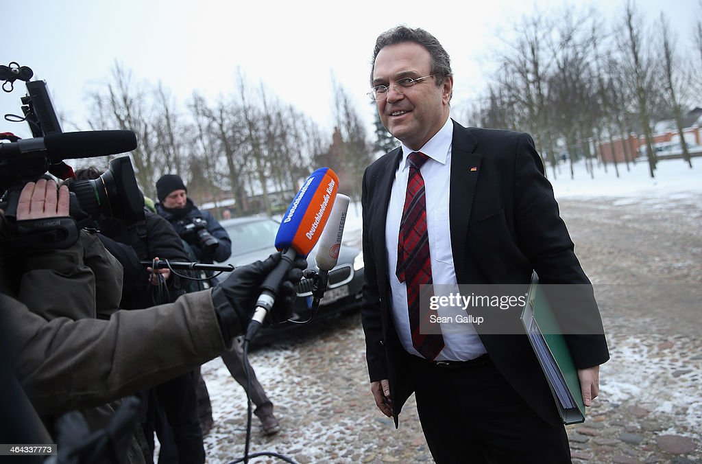 German Agriculture and Consumer Protection Minister <a gi-track='captionPersonalityLinkClicked' href=/galleries/search?phrase=Hans-Peter+Friedrich&family=editorial&specificpeople=7528072 ng-click='$event.stopPropagation()'>Hans-Peter Friedrich</a> arrives for the first day of the two-day German government cabinet meetings at Schloss Meseberg on January 22, 2014 in Meseberg, Germany. The government cabinet of Christian Democrats and Social Democrats is on a two-day retreat at Meseberg.