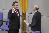 German Agriculture and Consumer Protection Minister HansPeter Friedrich takes his oath of office at the Bundestag during ceremonies in which the new...