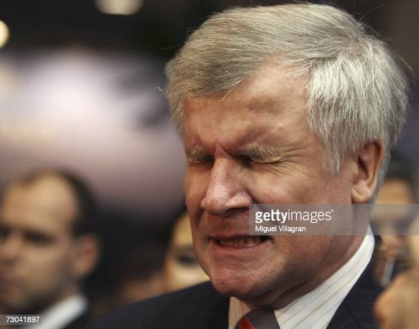 German Agriculture and Consumer Protection Minister Horst Seehofer reacts after drinking some liqueur as he tours the 72nd International Gruene Woche...