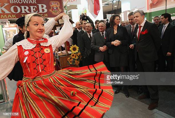 German Agriculture and Consumer Protection Minister Ilse Aigner and Berlin city mayor Klaus Wowereit watch a Polish folk dance ensmble perform while...