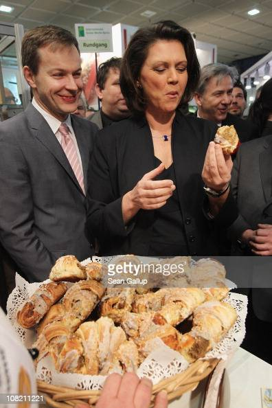 German Agriculture and Consumer Protection Minister Ilse Aigner tastes Polish pastries while touring the 2011 Gruene Woche international agricultural...