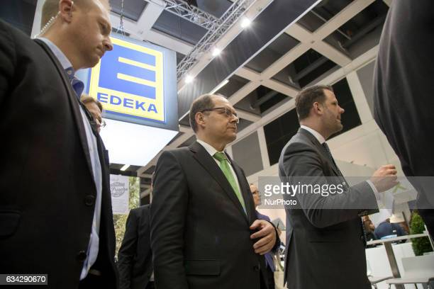 German Agriculture Minister Christian Schmidt leaves the Edeka stand during the opening tour of the 'Fruit Logistica' trade fair in Berlin Germany on...