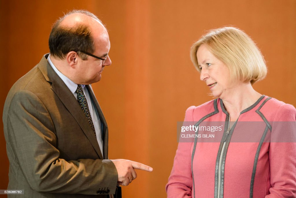 German Agriculture Minister Christian Schmidt (L) talks with German Education and Research Minister Johanna Wanka prior to the weekly cabinet meeting at the Federal Chancellery in Berlin, on May 4, 2016. / AFP / CLEMENS