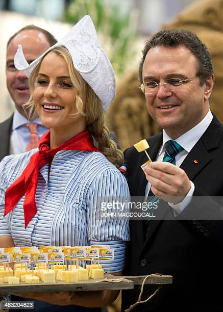 German Agriculture Minister HansPeter Friedrich samples some Dutch cheese at the Netherlands' stand of the Gruene Woche International Agriculture...