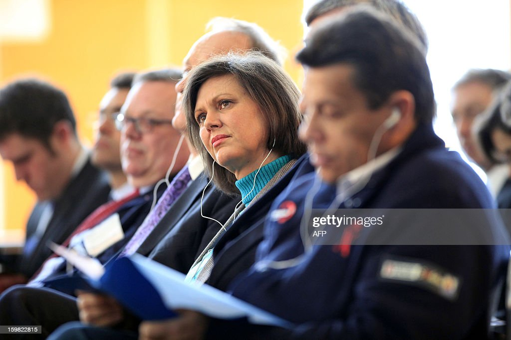 German Agriculture Minister Ilse Aigner (C) and her French counterpart Stephane Le Foll (2nd R) attend a workshop for young adults of both nations during the Gruene Woche (Green Week) as part of the celebration of the 50th anniversary of the Elysee treaty, at the exhibition grounds in Berlin, Germany on January 21, 2013.