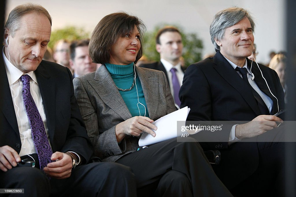 German Agriculture Minister Ilse Aigner () and her French counterpart Stephane Le Foll (R) attend a workshop for young adults of both nations during the Gruene Woche (Green Week) as part of the celebration of the 50th anniversary of the Elysee treaty, at the exhibition grounds in Berlin, Germany on January 21, 2013. AFP PHOTO / FREDERIC LAFARGUE