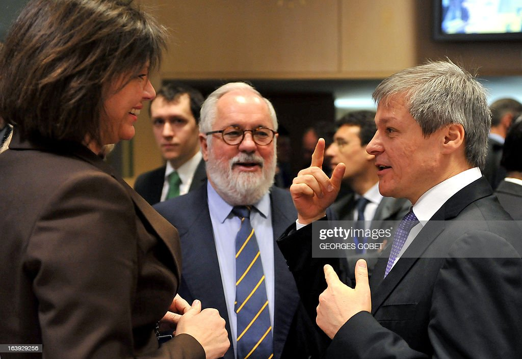 German Agriculture Minister Ilse Aigner (L), Spanish Agriculture and Environment Minister Miguel Arias Canete (C) and EU agriculture and rural development commissioner Dacian Ciolos talk on March 18, 2013 before the start of an Agriculture and Fisheries Council meeting at EU headquarters in Brussels. Agriculture ministers are to agree on the outline for reforming the common agriculture policy. GOBET