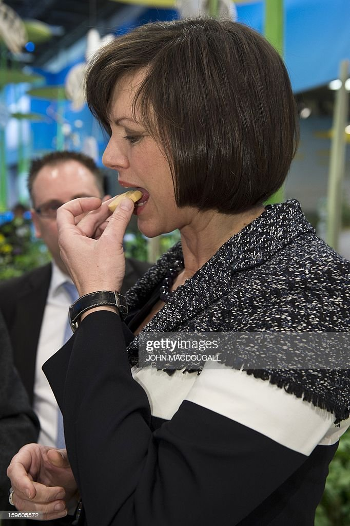 German Agriculture Minister Ilse Aigner tries a biscuit made with pea flour as she tours the German agriculture ministry's hall at the Gruene Woche (Green Week) Agricultural Fair in Berlin on January 17, 2013.