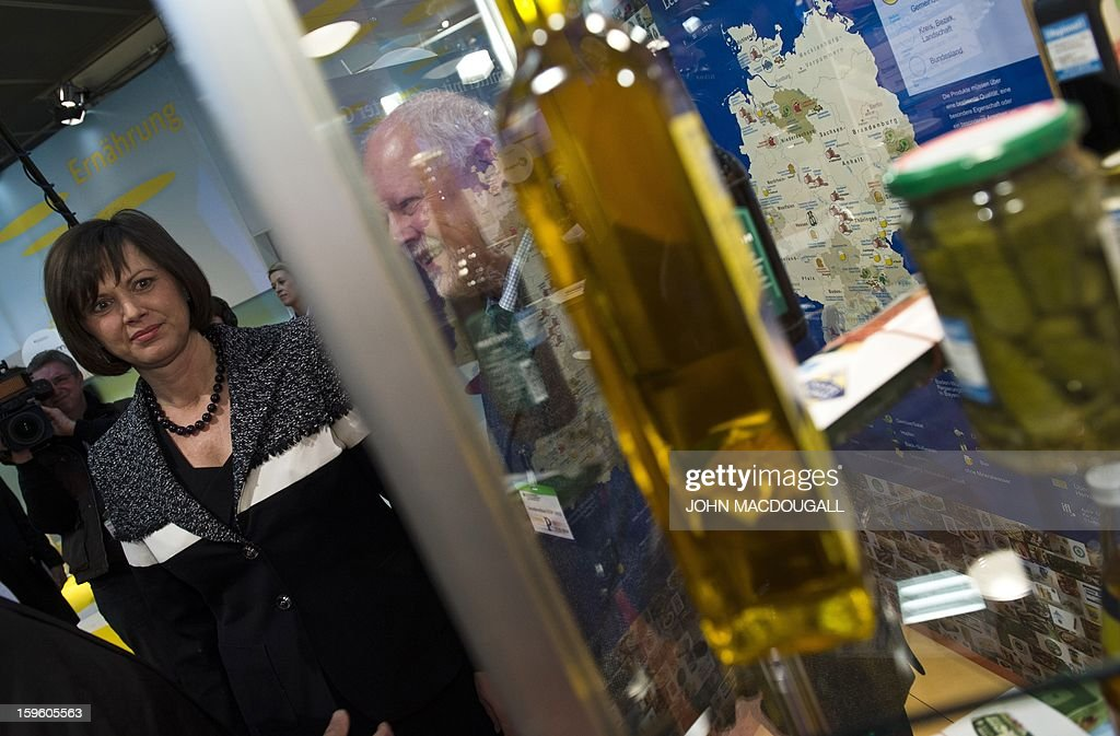 German Agriculture Minister Ilse Aigner vists a stand promoting regional produce as she tours the German agriculture ministry's hall at the Gruene Woche (Green Week) Agricultural Fair in Berlin on January 17, 2013. AFP PHOTO / JOHN MACDOUGALL
