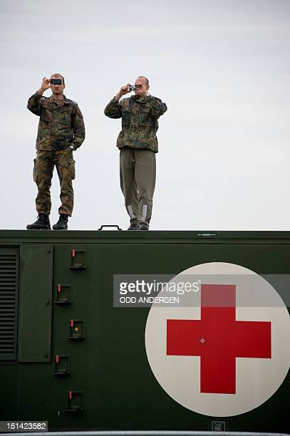 German airforce members take pictures from a medical container during the preparations for the Berlin airshow ILA in Schoenefeld outside Berlin...