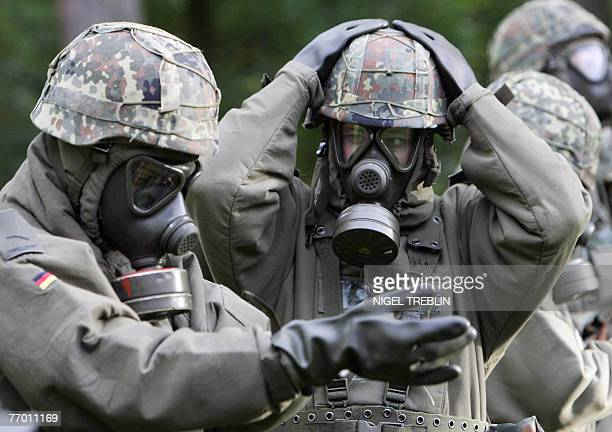 German airforce soldiers wearing protective suits against chemical and biological weapons take part in an ABCtraining exercise in their barracks in...