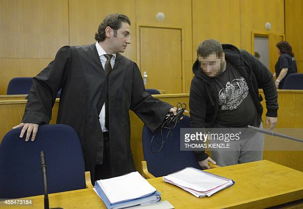 German alleged jihadist Kreshnik B takes his seat next to his lawyer Mutlu Guenal as he arrives at the higher regional court in Frankfurt am Main...