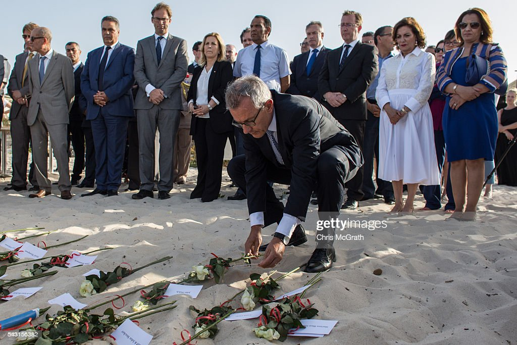 German Ambassador to Tunisia Andreas Reinicke lays a rose for each of the German victims of the 2015 Sousse Beach terrorist attack during a memorial service on the beach in front of the Imperial Marhaba hotel on June 26, 2016 in Sousse, Tunisia. Today marks the one year anniversary of the Sousse Beach terrorist attack, which killed 38 people including 30 Britons. Before the 2011 revolution, tourism in Tunisia accounted for approximately 7% of the countries GDP. The two 2015 terrorist attacks at the Bardo Museum and Sousse Beach saw tourism numbers plummet even further forcing hotels to close and many tourism and hospitality workers to lose their jobs.
