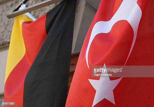 German and a Turkish flag hang from windows on an apartment building two days ahead of the Germany vs Turkey Euro 2008 semifinals football match on...
