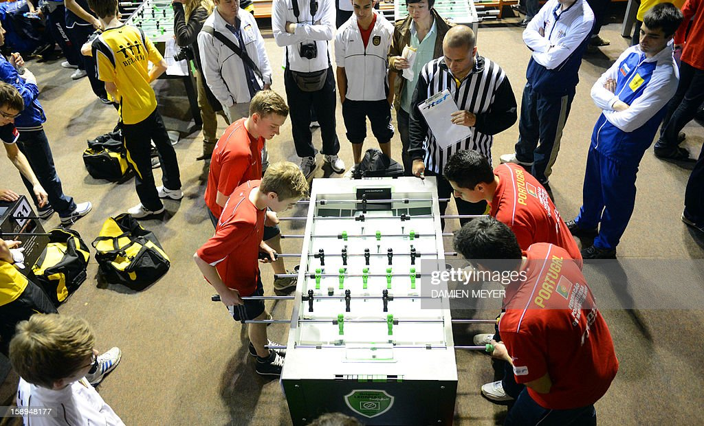 German (L) and Portuguese (R) competitors take part in the ITSF 2013 table soccer (aka babyfoot) World Cup on January 4, 2013 in Nantes, western France.