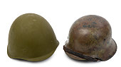German and Soviet helmets isolated on the white background