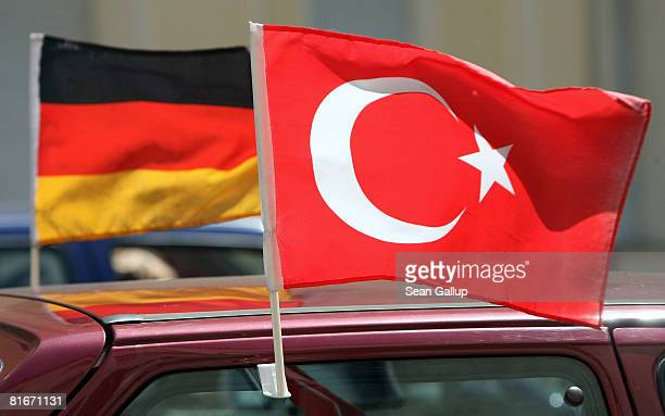 German and Turkish flags flutter while attached to a car in the immigrantheavy district of Wedding two days ahead of the Germany vs Turkey Euro 2008...