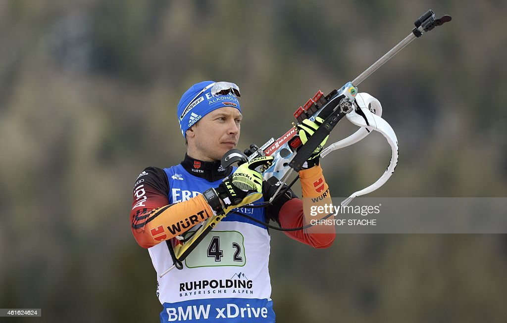 German Andreas Birnbacher prepares his gun ahead of the men's 4 x 75 km relay at the Biathlon World Cup on January 15 in Ruhpolding southern Germany...