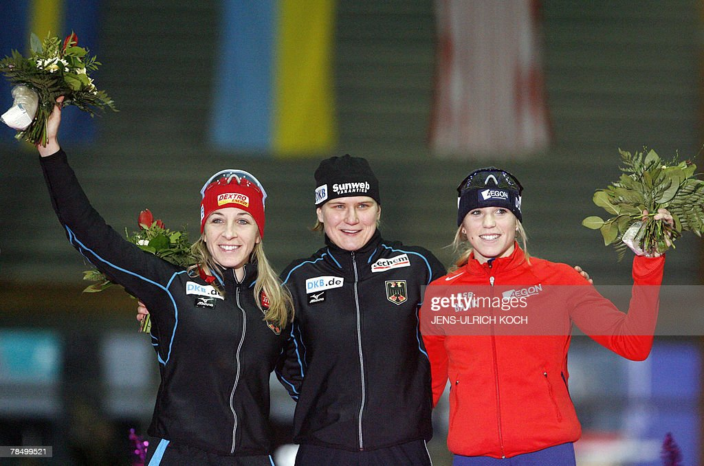 German Anni Friesinger, second, winner compatriot Jenny Wolf and third placed Dutch Annette Gerritson celebrate on the podium of the women's 500m race of the speed Skating World Cup, 15 December 2007 at the Gunda-Niemann-Stirnemann Hall in the eastern town of Erfurt.