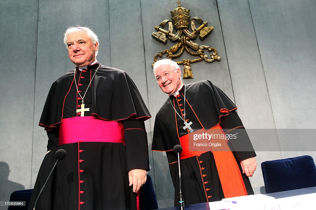 German archbishop Gerhard Ludwig Muller (L) and Canadian Cardinal <a gi-track='captionPersonalityLinkClicked' href=/galleries/search?phrase=Marc+Ouellet&family=editorial&specificpeople=3145328 ng-click='$event.stopPropagation()'>Marc Ouellet</a> (R), prefect of the Congregation for the Doctrine of the Faith attend a press conference at the Holy See Press Office for the presentation of Pope Francis' first encyclical, entitled 'Lumen Fidei' (The Light of Faith) on July 5, 2013 in Vatican City, Vatican. The document continues many of Benedict's favourite themes, from the complementarity of faith and reason, to the joy of a personal encounter with Christ. Firmly situated in the Year of Faith, it's also set in the context of the 50th anniversary of the Second Vatican Council, which re-established the central role of Faith at the heart of all human relationships.