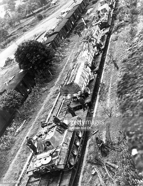 German army reinforcements on the front in Normandy trucks and Panther tanks on a train in a small Normandy railway station identical with image no...