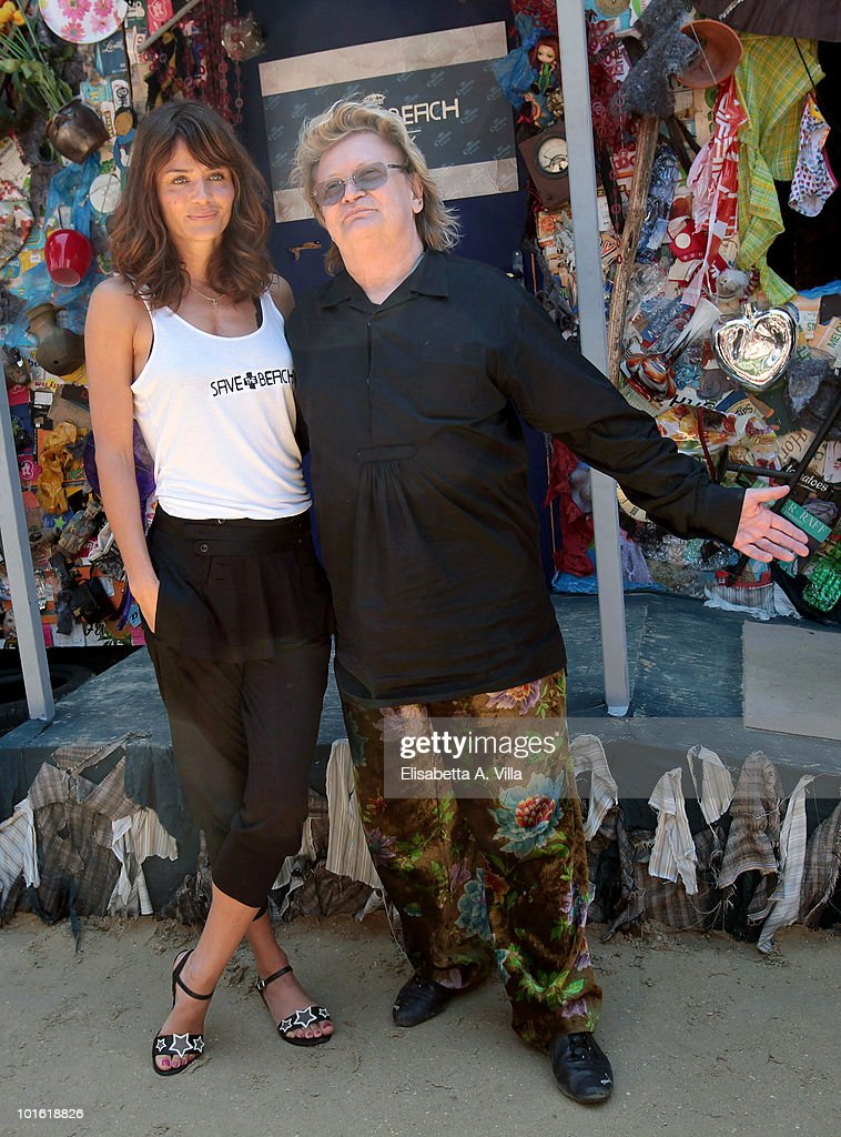 German artist Ha Schult and model <a gi-track='captionPersonalityLinkClicked' href=/galleries/search?phrase=Helena+Christensen&family=editorial&specificpeople=202841 ng-click='$event.stopPropagation()'>Helena Christensen</a> attend a photocall for 'Corona Save The Beach' Hotel at Castel Sant'Angelo on June 4, 2010 in Rome, Italy. 'Corona Save The Beach' created by Ha Schult, is the first hotel in the world built with trash collected from European beaches. <a gi-track='captionPersonalityLinkClicked' href=/galleries/search?phrase=Helena+Christensen&family=editorial&specificpeople=202841 ng-click='$event.stopPropagation()'>Helena Christensen</a> was the first hotel guest.