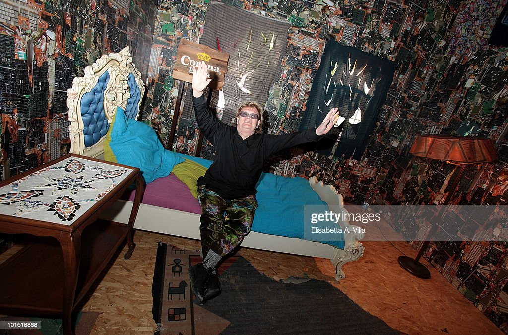 German artist Ha Schult poses inside the 'Corona Save The Beach' Hotel at Castel Sant'Angelo on June 4, 2010 in Rome, Italy. 'Corona Save The Beach' created by Ha Schult, is the first hotel in the world built with trash collected from European beaches. Helena Christensen was the first hotel guest.