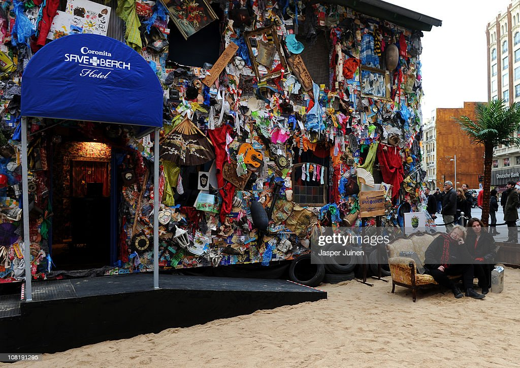 German artist Ha Schult sits on a couch in front of the five-room Beach Garbage Hotel on January 20, 2011 in Madrid, Spain. The hotel on the Spanish capital center Plaza de Callao has been made entirely of waste found at dumps, beaches and flea markets to protest the world's dirty oceans.