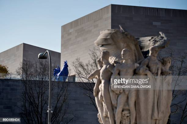 German artist Katharina Fritsch's 'Hahn/Cock' is seen atop National Gallery of Art's East Building with the George Gordon Meade Memorial in the...