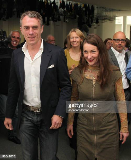 German artist Neo Rauch and his wife Rosa Loy arrive for the preview of the exhibition 'Begleiter' at Pinakothek der Moderne art museum on April 19...